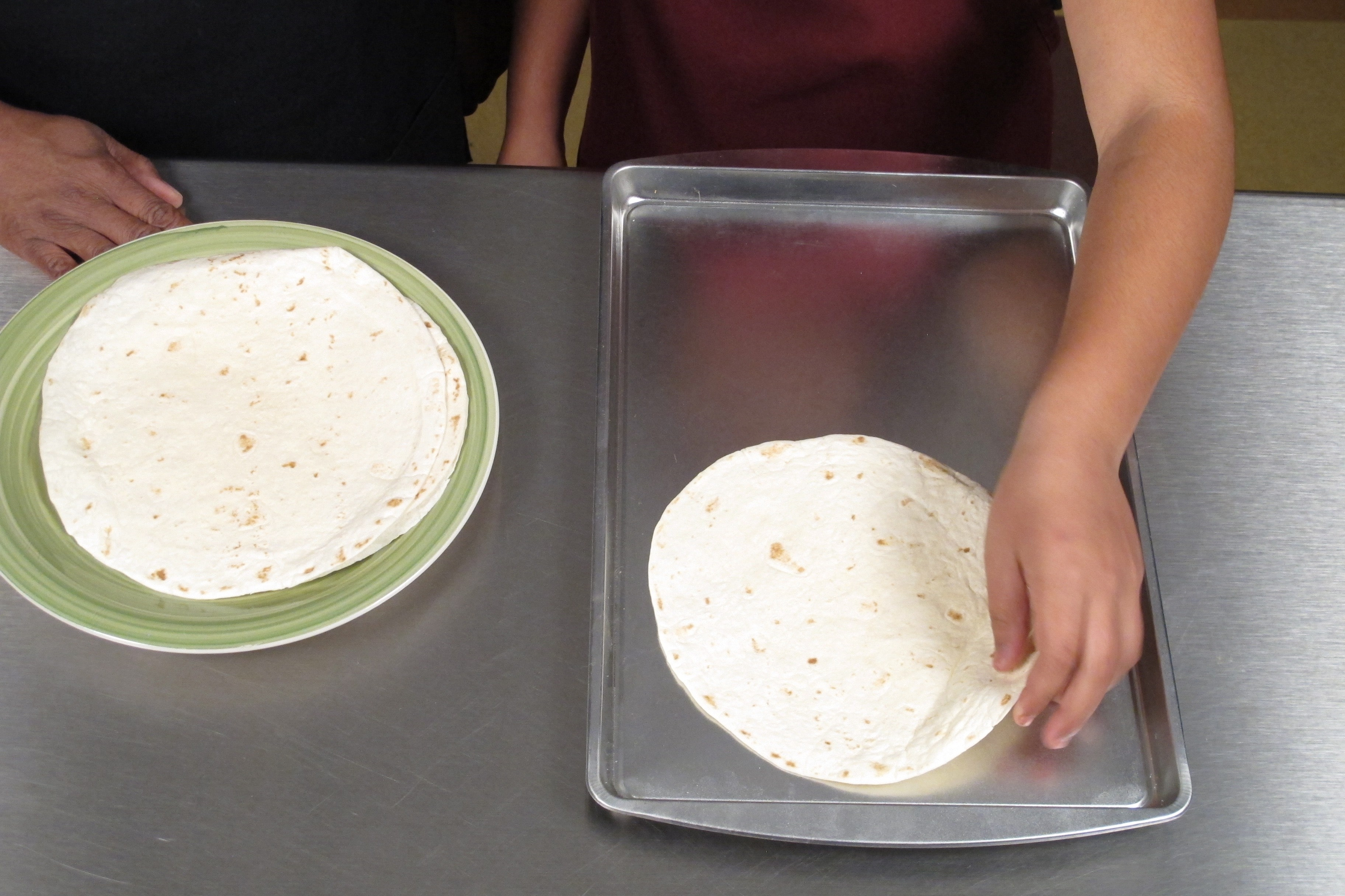 Place tortillas on two large baking sheets. Cook for 5 minutes and flip. Cook for 5 more minutes. Put to the side.